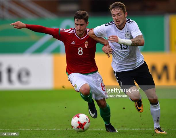 Jannes Horn of Germany U21 is challenged by Mate Katona of Hungary 21 during the International friendly match between Germany U21 and Hungary U21 at...