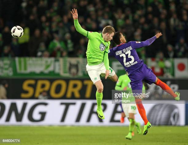 Jannes Horn of Wolfsburg and Serge Gnabry of Werder Bremen battle for the ball during the Bundesliga match between VfL Wolfsburg and Werder Bremen at...