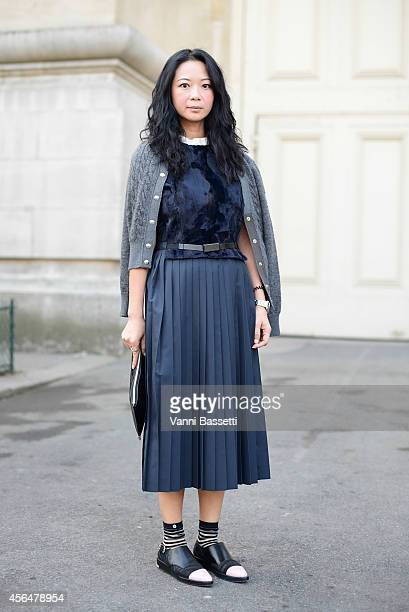 Jannet Liu poses wearing a Moncler cardigan and Toga skirt and shoes on October 1 2014 in Paris France