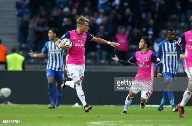 JannFiete Arp and Ito Tatsuya of Hamburger SV celebrates their teams first goal scoring during the Bundesliga match between Hertha BSC and Hamburger...