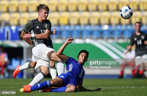 JannFiete Arp of Germany and Alon Strosberg of Israel vie for the ball during the Under 17 four nations tournament match between U17 Germany and U17...