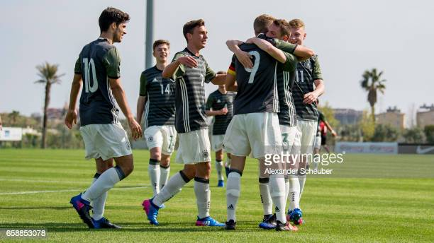 JannFiete Arp of Germany celebrates the first goal for his team with his teammates during the UEFA U17 elite round match between Germany and Turkey...