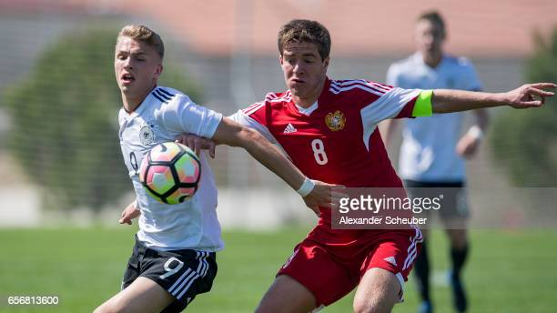 JannFiete Arp of Germany challenges Arsen Yeghiazaryan of Armenia during the UEFA U17 elite round match between Germany and Armenia on March 23 2017...
