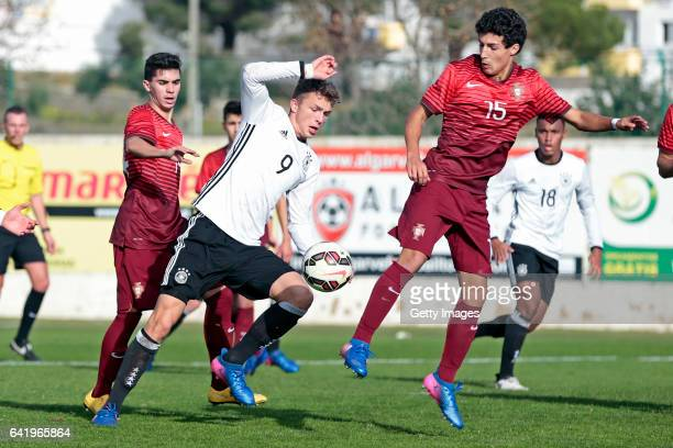 JannFiete Arp of Germany U17 challenges Vitor Ferreira and João Oliveira of Portugal U17 during the U17 Algarve Cup Tournament Match between Portugal...
