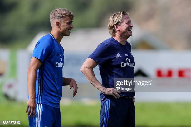 JannFiete Arp of Hamburg and Head coach Markus Gisdol of Hamburg looks on during the Training Camp of Hamburger SV on July 23 2017 in Laengenfeld...