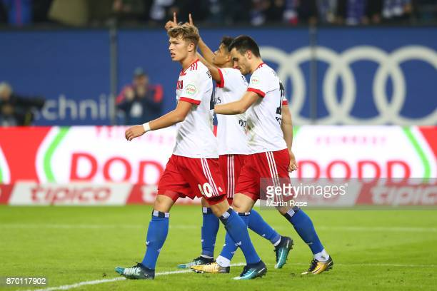 JannFiete Arp of Hamburg Douglas Santos of Hamburg and Filip Kostic of Hamburg celebrate after Kostic scored a goal to make it 21 during the...