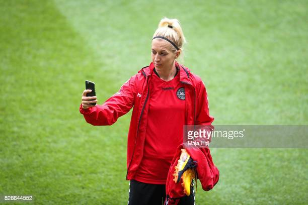 Janni Arnth of Denmark makes a picture during a training prior UEFA Women's Euro 2017 Final against Netherlands at De Grolsch Veste Stadium on August...