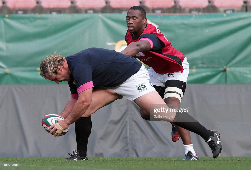 Jannie du Plessis and <a gi-track='captionPersonalityLinkClicked' href=/galleries/search?phrase=Siya+Kolisi&family=editorial&specificpeople=7038891 ng-click='$event.stopPropagation()'>Siya Kolisi</a> of the Springboks in action during the South African National rugby team captain's run at DHL Newlands on September 27, 2013 in Cape Town, South Africa.