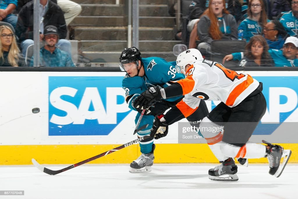 Jannik Hansen #36 of the San Jose Sharks and Andrew MacDonald #47 of the Philadelphia Flyers battle for the puck during a NHL game at SAP Center at San Jose on October 4, 2017 in San Jose, California.