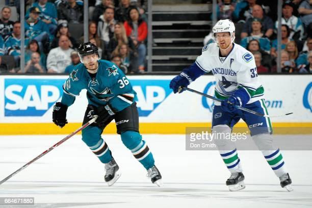 Jannik Hansen of the San Jose Sharks skates against Henrik Sedin of the Vancouver Canucks at SAP Center at San Jose on April 4 2017 in San Jose...