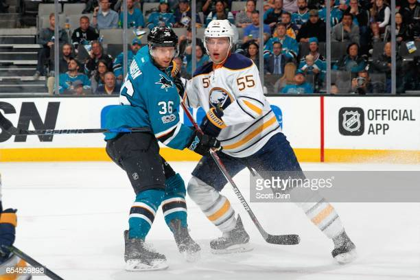 Jannik Hansen of the San Jose Sharks skates against Rasmus Ristolainen of the Buffalo Sabres at SAP Center at San Jose on March 14 2017 in San Jose...