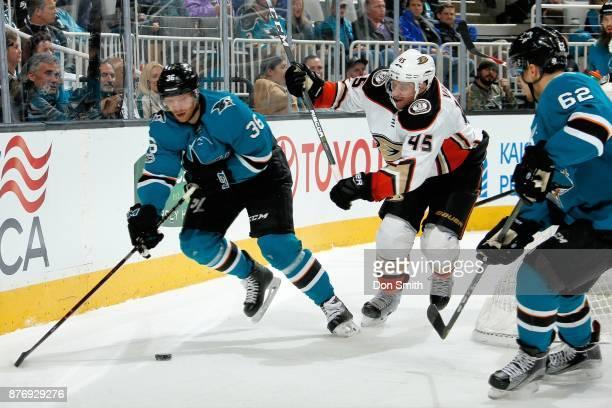Jannik Hansen of the San Jose Sharks skates against Sami Vatanen of the Anaheim Ducks at SAP Center on November 20 2017 in San Jose California