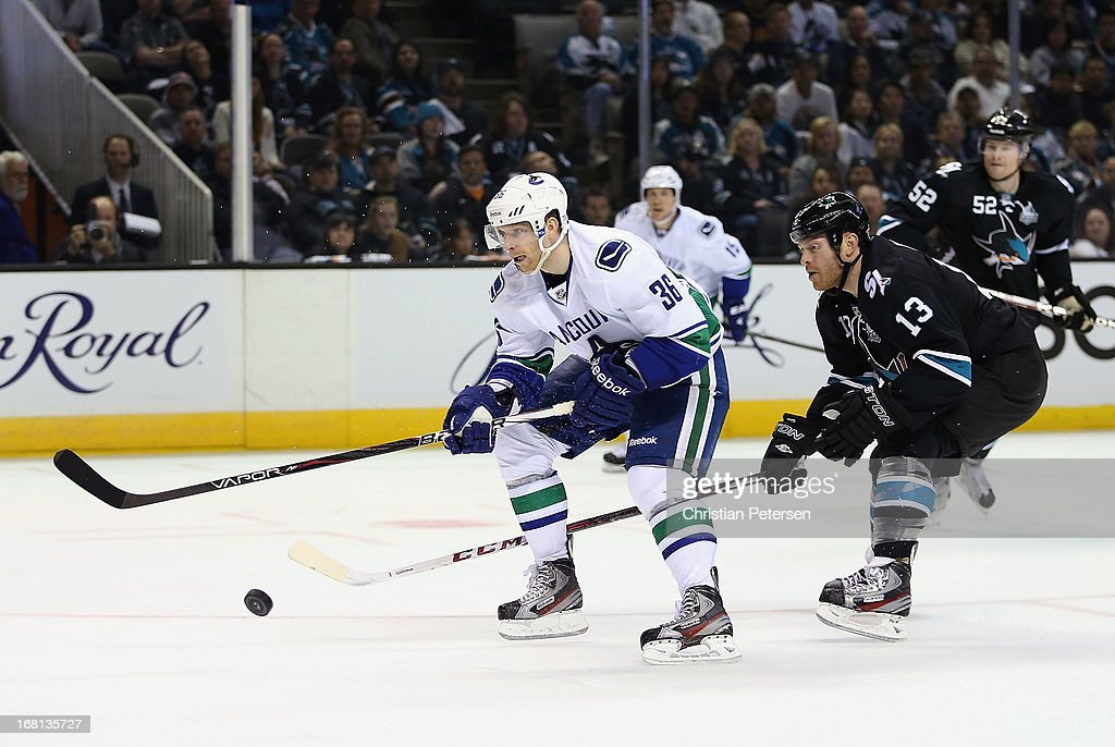 <a gi-track='captionPersonalityLinkClicked' href=/galleries/search?phrase=Jannik+Hansen&family=editorial&specificpeople=741716 ng-click='$event.stopPropagation()'>Jannik Hansen</a> #36 of the Vancouver Canucks breaks in with the puck ahead of <a gi-track='captionPersonalityLinkClicked' href=/galleries/search?phrase=Raffi+Torres&family=editorial&specificpeople=204612 ng-click='$event.stopPropagation()'>Raffi Torres</a> #13 of the San Jose Sharks in the third period of Game Three of the Western Conference Quarterfinals during the 2013 NHL Stanley Cup Playoffs at HP Pavilion on May 5, 2013 in San Jose, California. The Sharks defeated the Canucks 5-2.