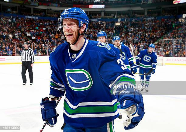 Jannik Hansen of the Vancouver Canucks celebrates a victory against the Edmonton Oilers after their NHL game at Rogers Arena April 11 2015 in...
