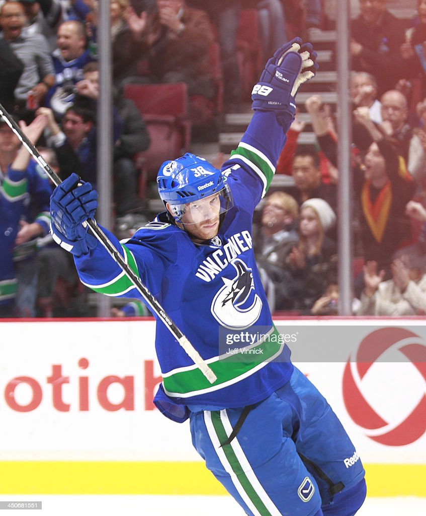 Jannik Hansen #36 of the Vancouver Canucks celebrates after scoring against the Florida Panthers during their NHL game at Rogers Arena on November 19, 2013 in Vancouver, British Columbia, Canada. Florida won 3-2 in a shootout.