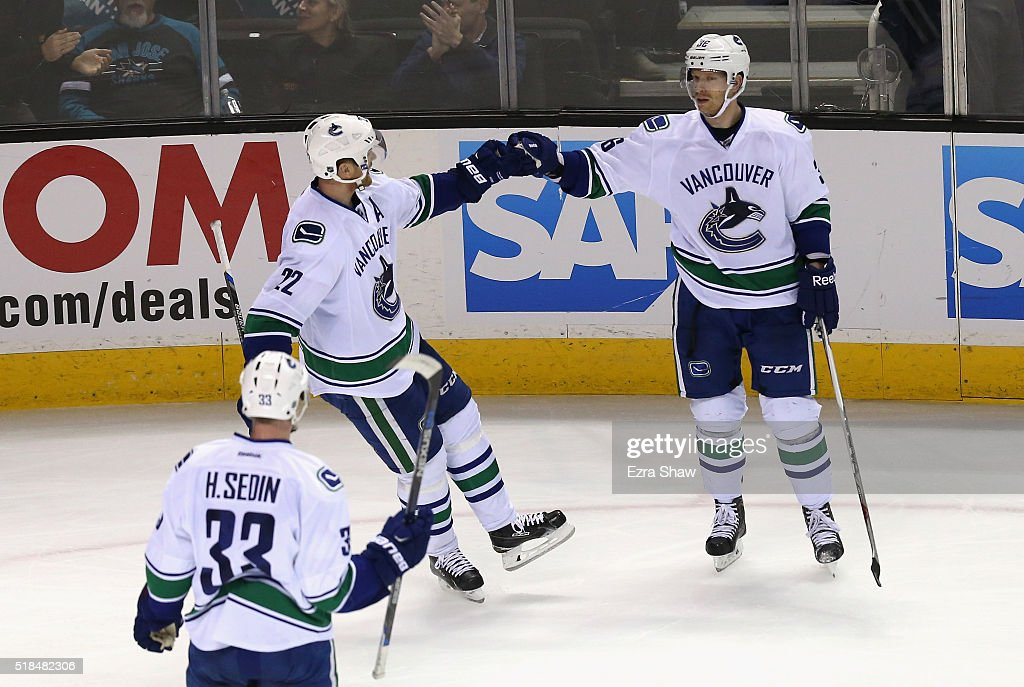 Jannik Hansen #36 of the Vancouver Canucks is congratulated by Daniel Sedin #22 and Henrik Sedin #33 of the Vancouver Canucks after he scored a goal in the third period against the San Jose Sharks at SAP Center on March 31, 2016 in San Jose, California.