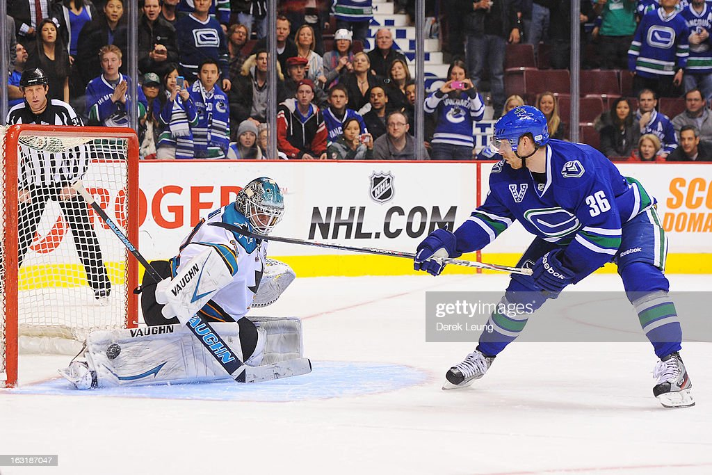 Jannik Hansen #36 of the Vancouver Canucks misses his shoot-out shot on Antti Niemi #31 of the San Jose Sharks during an NHL game at Rogers Arena on March 5, 2013 in Vancouver, British Columbia, Canada.