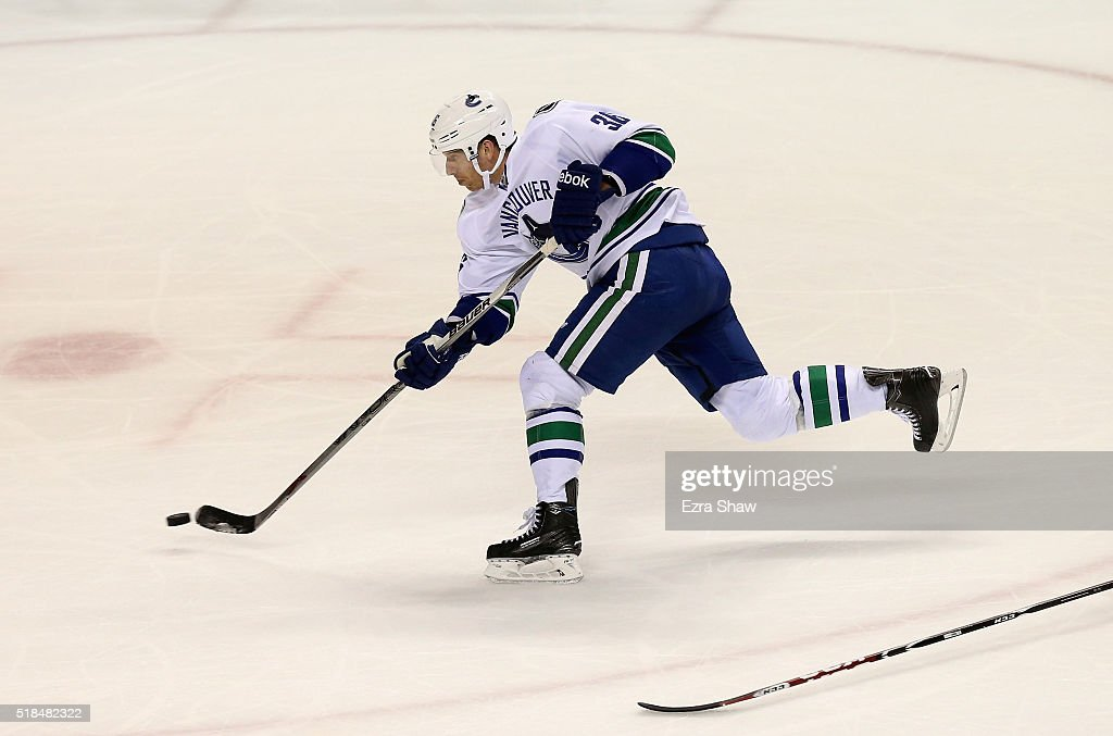 Jannik Hansen #36 of the Vancouver Canucks scores a goal in the third period against the San Jose Sharks at SAP Center on March 31, 2016 in San Jose, California.