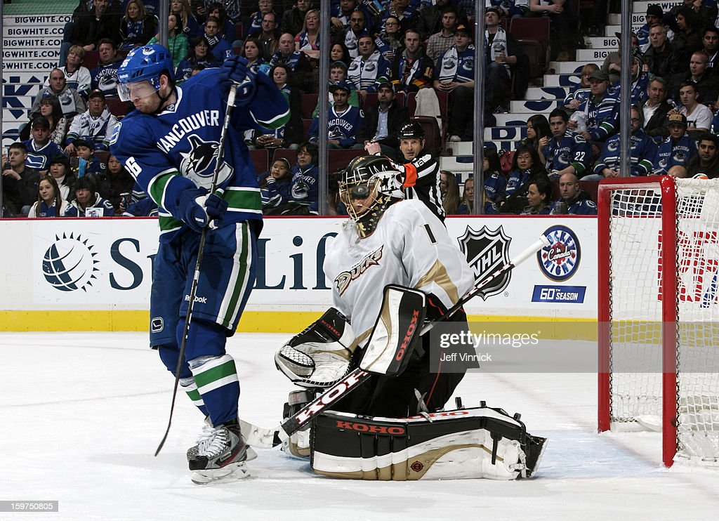 Jannik Hansen #36 of the Vancouver Canucks tips the puck past Jonas Hiller #1 of the Anaheim Ducks during their season-opening NHL game at Rogers Arena January 19, 2013 in Vancouver, British Columbia, Canada. Anaheim won 7-3.