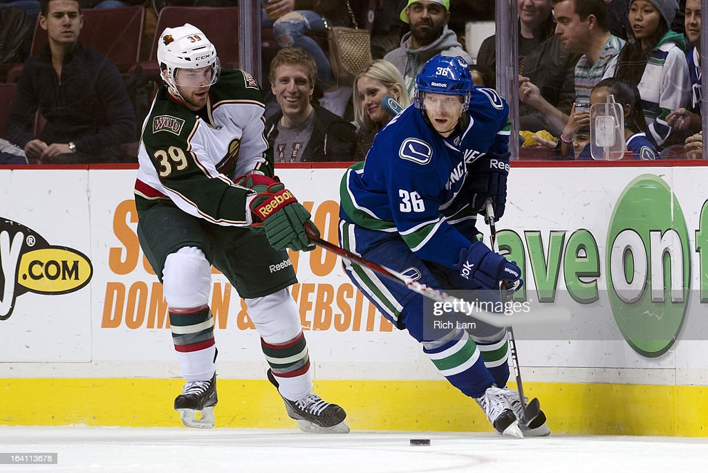 Jannik Hansen #36 of the Vancouver Canucks tries to break free from Nate Prosser #39 of the Minnesota Wild during NHL action on March 18, 2013 at Rogers Arena in Vancouver, British Columbia, Canada.