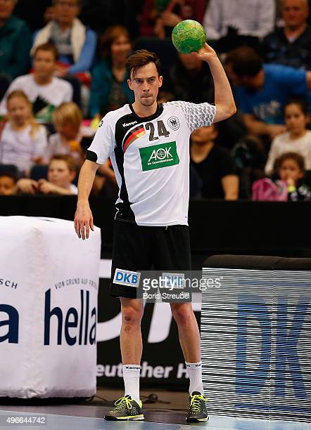 Jannik Kohlbacher of Germany in action during the men's Handball Supercup between Germany and Serbia at Barclaycard Arena on November 7 2015 in...