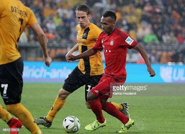 Jannik Mueller of Dresden challenges Julian Green of Bayern Muenchen during the friendly match between SG Dynamo Dresden and FC Bayern Muenchen at...