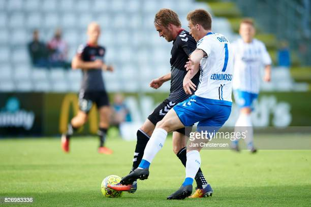 Jannik Pohl of AaB Aalborg and Jóan Símun Edmundsson of OB Odense compete for the ball during the Danish Alka Superliga match between OB Odense and...