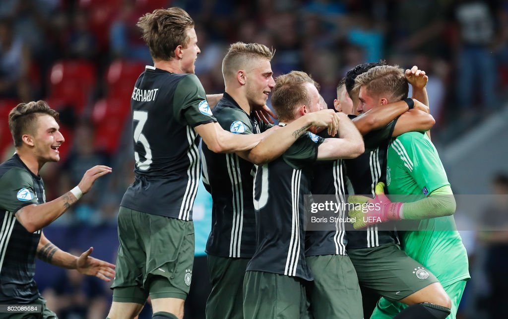 Jannik Pollersbeck of Germany celebrates with his team mates after he saved a penalty from Nathan Redmond of England (not pictured) to win his side the penalty shoot out after the UEFA European Under-21 Championship Semi Final match between England and Germany at Tychy Stadium on June 27, 2017 in Tychy, Poland.