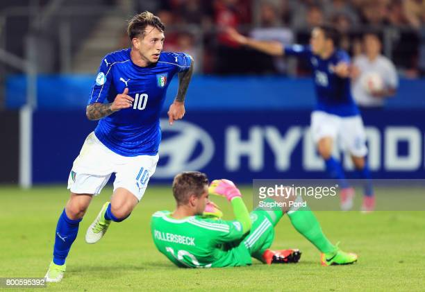 Jannik Pollersbeck of Germany looks dejected as Federico Bernardeschi of Italy celebrates as he scores their first goal during the 2017 UEFA European...
