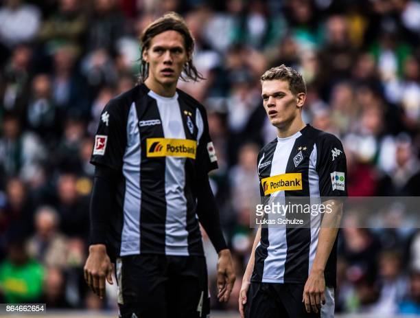 Jannik Vestergaard and Matthias Ginter of Moenchengladbach look disappointed during the Bundesliga match between Borussia Moenchengladbach and Bayer...