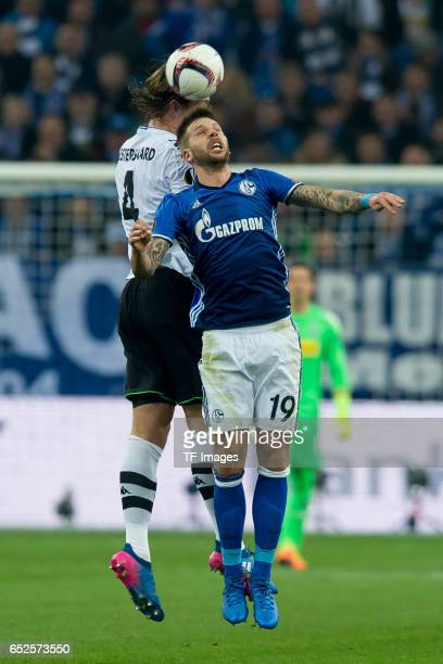 Jannik Vestergaard of Borussia Moenchengladbach and Guido Burgstaller of Schalke battle for the ball during the UEFA Europa League Round of 16 first...