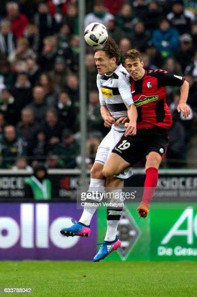 Jannik Vestergaard of Borussia Moenchengladbach and Janik Haberer of SC Freiburg battle for the ball during the Bundesliga Match between Borussia...