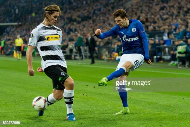 Jannik Vestergaard of Borussia Moenchengladbach and Leon Goretzka of Schalke battle for the ball during the UEFA Europa League Round of 16 first leg...