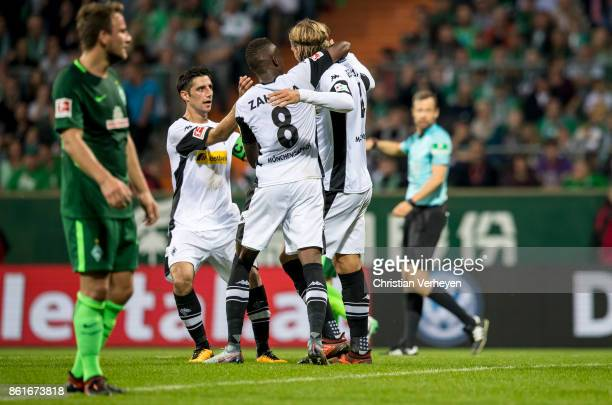 Jannik Vestergaard of Borussia Moenchengladbach celebrate with his team mates Lars Stindl and Denis Zakaria after he scores his teams first goal...