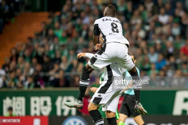 Jannik Vestergaard of Borussia Moenchengladbach celebrate with his team mate Denis Zakaria after he scores his teams first goal during the Bundesliga...