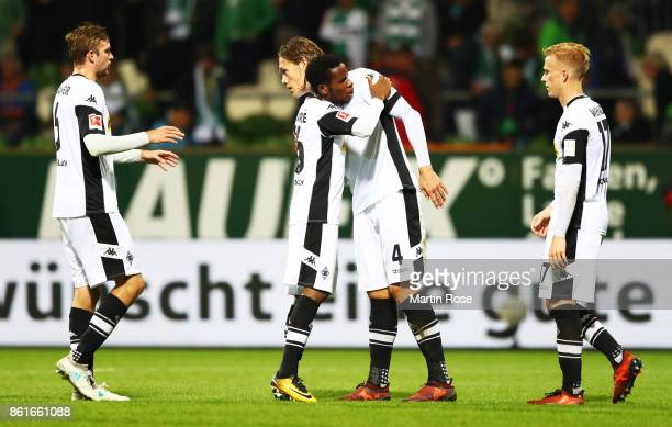 Jannik Vestergaard of Borussia Moenchengladbach is congratulated by Christoph Kramer of Borussia Moenchengladbach after winning the Bundesliga match...