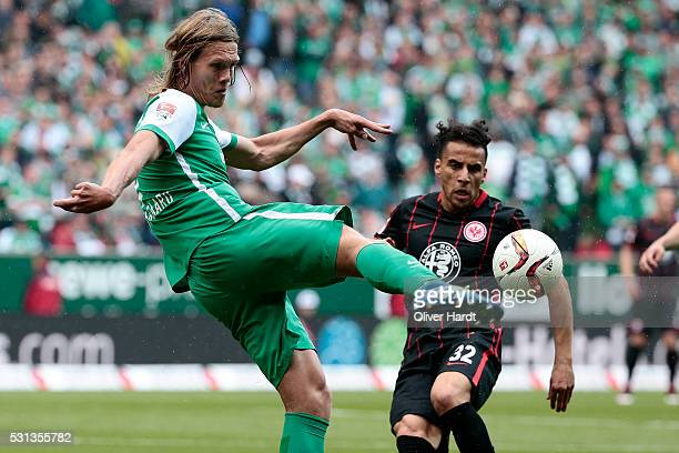Jannik Vestergaard of Bremen and Aenis Ben Hatira of Frankfurt compete for the ball during the Bundesliga match SV Werder Bremen and Eintracht...