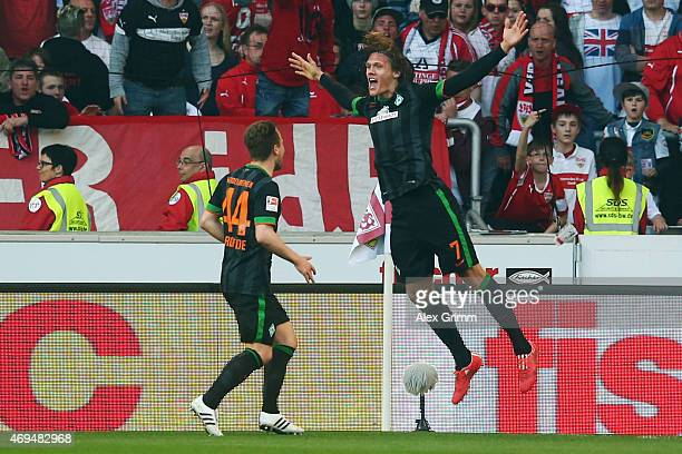 Jannik Vestergaard of Bremen celebrates his team's second goal with team mate Philipp Bargfrede during the Bundesliga match between VfB Stuttgart and...
