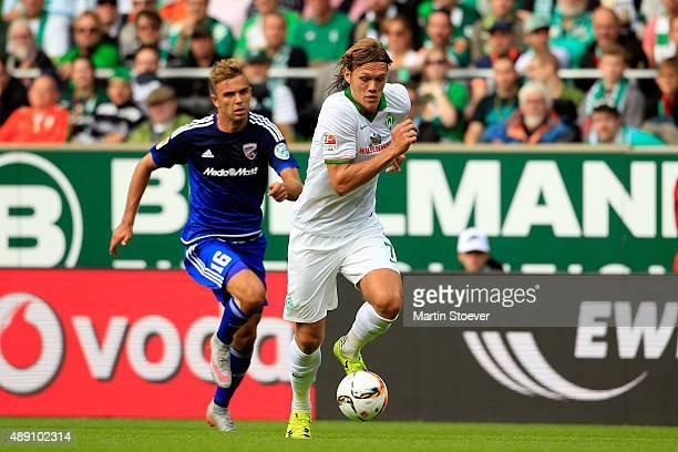 Jannik Vestergaard of Bremen challenges Lukas Hinterseer of Ingolstadt during the Bundesliga match between Werder Bremen and FC Ingolstadt at...