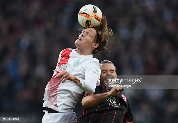 Jannik Vestergaard of Bremen jumps for a header with Alexander Meier of Frankfurt during the Bundesliga match between Eintracht Frankfurt and Werder...