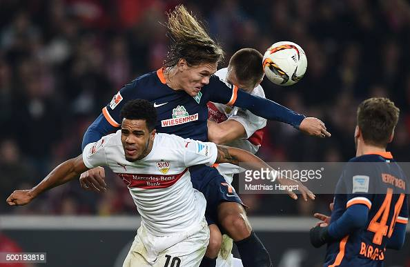 Jannik Vestergaard of Bremen jumps for a header with Daniel Didavi of Stuttgart and Toni Sunjic of Stuttgart during the Bundesliga match between VfB...