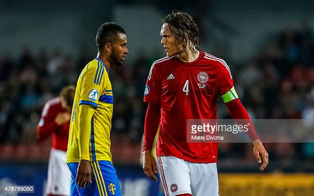 Jannik Vestergaard of Denmark discuss with Isaac Kiese Thelin of Sweden during UEFA U21 European Championship semi final match between Denmark and...