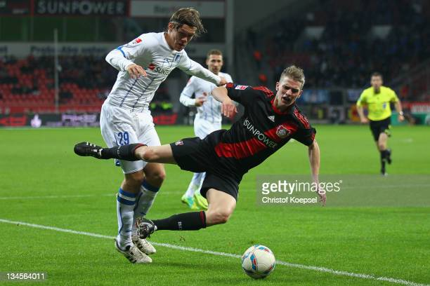 Jannik Vestergaard of Hoffenheim attacks Lars Bender of Leverkusen during the Bundesliga match between Bayer 04 Leverkusen and 1899 Hoffenheim at...