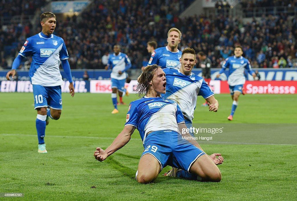 Jannik Vestergaard of Hoffenheim celebrates with his teammates after scoring his team's third goal during the Bundesliga match between TSG 1899...
