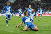 Jannik Vestergaard of Hoffenheim celebrates with his teammates after scoring his team's third goal during the Bundesliga match between TSG 1899...