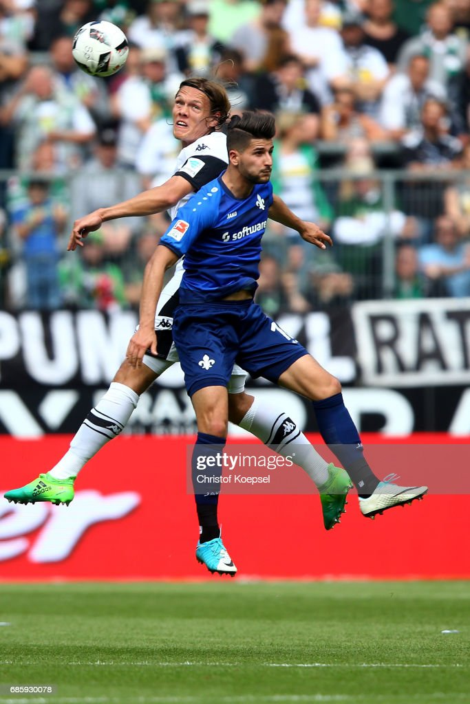Jannik Vestergaard of Moenchengladbach and Antonio Colak of Darmstadt go up for a header during the Bundesliga match between Borussia Moenchengladbach and SV Darmstadt 98 at Borussia-Park on May 20, 2017 in Moenchengladbach, Germany.