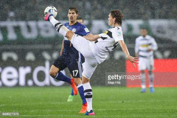 Jannik Vestergaard of Moenchengladbach and Benjamin Stambouli of Schalke battle for the ball during the Bundesliga match between Borussia...