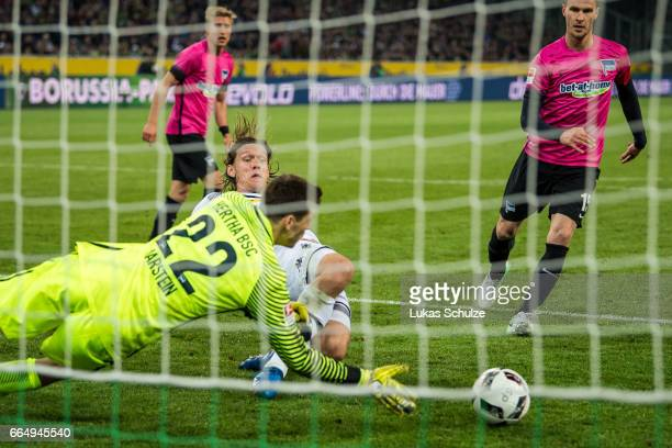 Jannik Vestergaard of Moenchengladbach and Goalkeeper Rune Jarstein of Berlin in action during the Bundesliga match between Borussia Moenchengladbach...