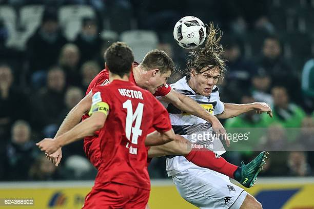 Jannik Vestergaard of Moenchengladbach battles for the ball with Dominique Heintz of Koeln during the Bundesliga match between Borussia...