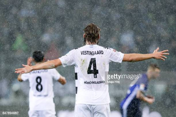 Jannik Vestergaard of Moenchengladbach reacts during heavy rain during the Bundesliga match between Borussia Moenchengladbach and FC Schalke 04 at...
